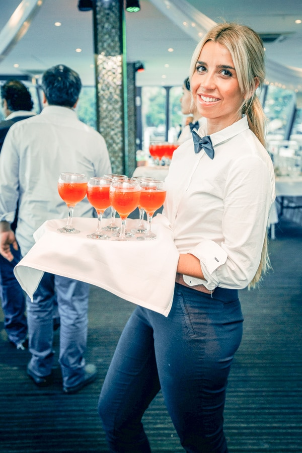 Waitress serving drinks